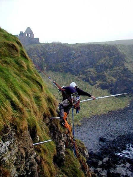Cintec anchors being installed to the cliff face at Dunluce Castle, by rope access, Co. Antrim, Northern Ireland