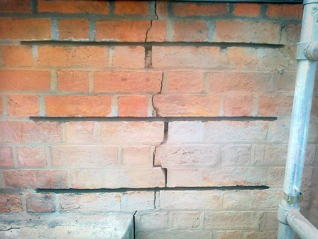 Cracks in the masonry: crack stitching method to repair the structural cracks, at Queens University, Belfast, Co. Antrim, NI