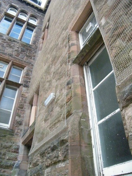 Masonry consolidation netting was fixed to the stone walls, providing a discreet finish, at Belfast Royal Academy, Co. Antrim, NI