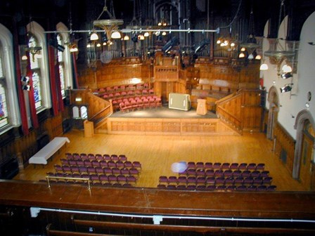 The existing main council chamber, within which, Stronghold Preservation carried out remedial timber repairs for wet rot, dry rot and woodworm, at The Guildhall, Londonderry, Northern Ireland